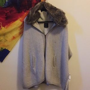 Thick knit poncho with fur hood
